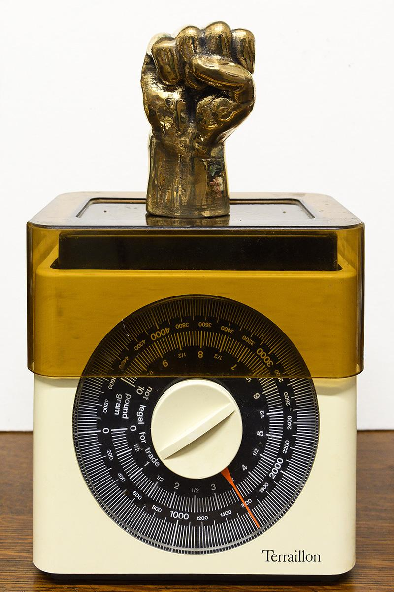 Azikiwe Mohammed Approximate Weight Of My Hair From Birth To Age 35, 2020 bronze and kitchen scale, 29.2 x 17.8 x 11.4 cm. Courtesy the artists and David Kordansky, Los Angeles