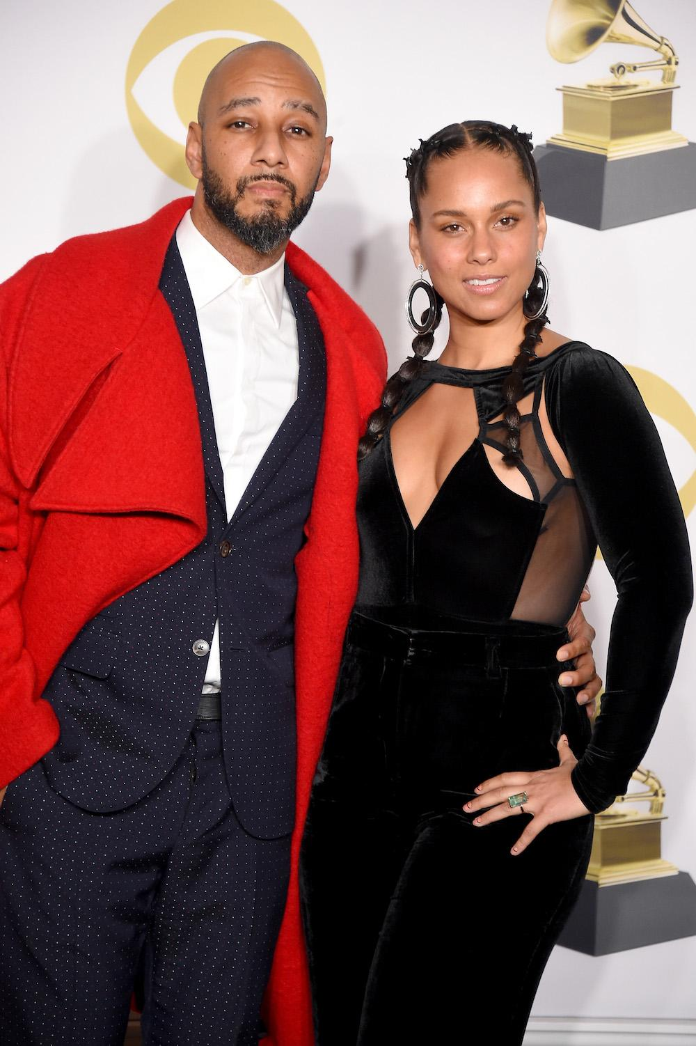 Recording artists Swizz Beatz (L) and Alicia Keys pose in the press room during the 60th Annual GRAMMY Awards at Madison Square Garden on January 28, 2018 in New York City. (Photo by Michael Loccisano/Getty Images for NARAS)