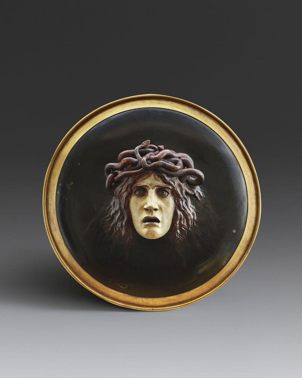 Arnold Böcklin (1827-1901)Shield with the Head of MedusaPolychrome plaster and papier-mâchéDiameter: 60.5 cmConceived in 1885 and modelled around 1887