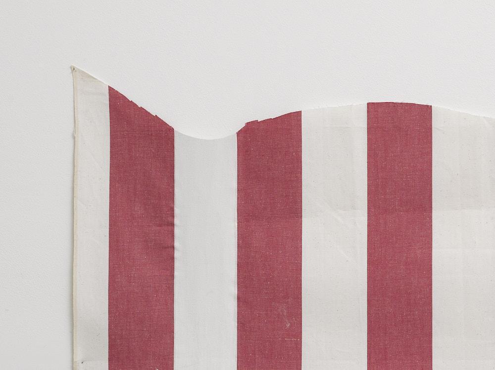 Daniel Buren  Une pièce coupée en deux, 1974  Painting on linen cloth  74 x 142 cm (installed)  29 1/8 x 55 7/8 in (installed)  70.5 x 141 cm (prior to cutting)  27 3/4 x 55 1/2 in (prior to cutting)   © Daniel Buren. Courtesy Lisson Gallery