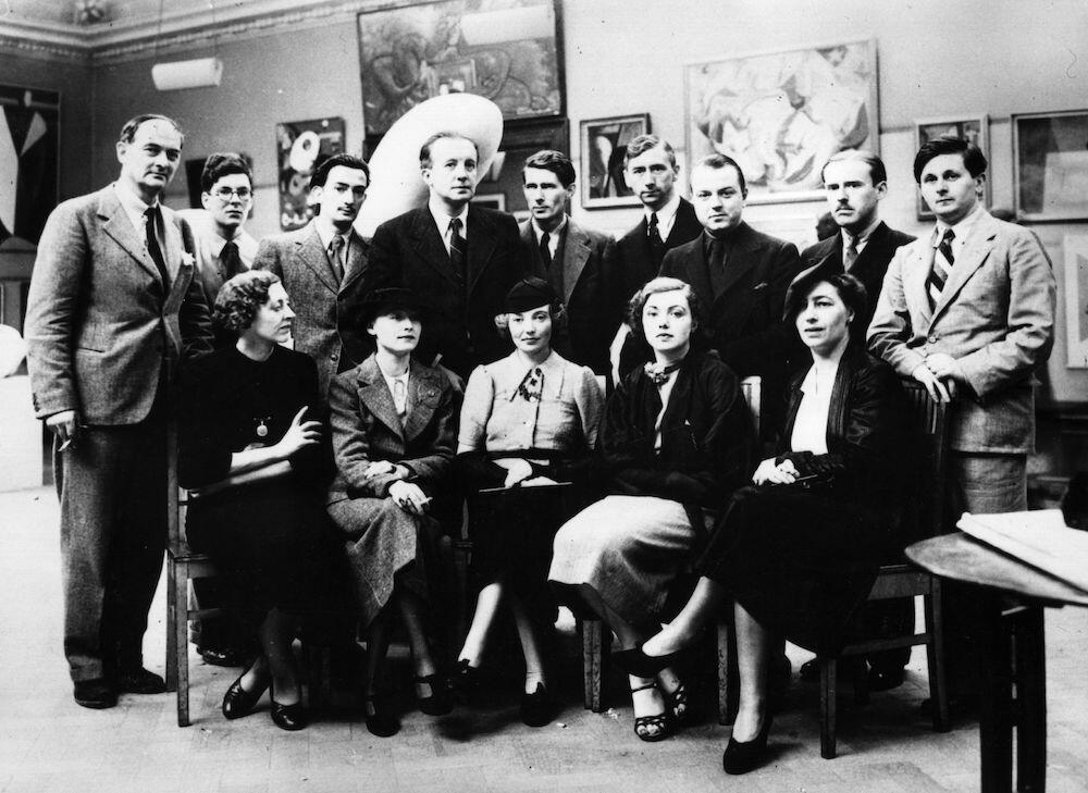 Group Of Surrealists Salvador Dali (1904 - 1989) Spanish Surrealist painter with other artists at the first Surrealist Exhibition to be held in London. Back row, from left, are Rupert Lee, Ruthven Todd, Salvador Dali, Paul Eluard, Roland Penrose, Herbert Read, E LT Mesens, George Reavey and Hugh Sykes-Davies. Front row, from left, Diana Lee, Nusch Eluard, Eileen Agar, Sheila Legge and unknown. (Photo by Evening Standard/Getty Images)