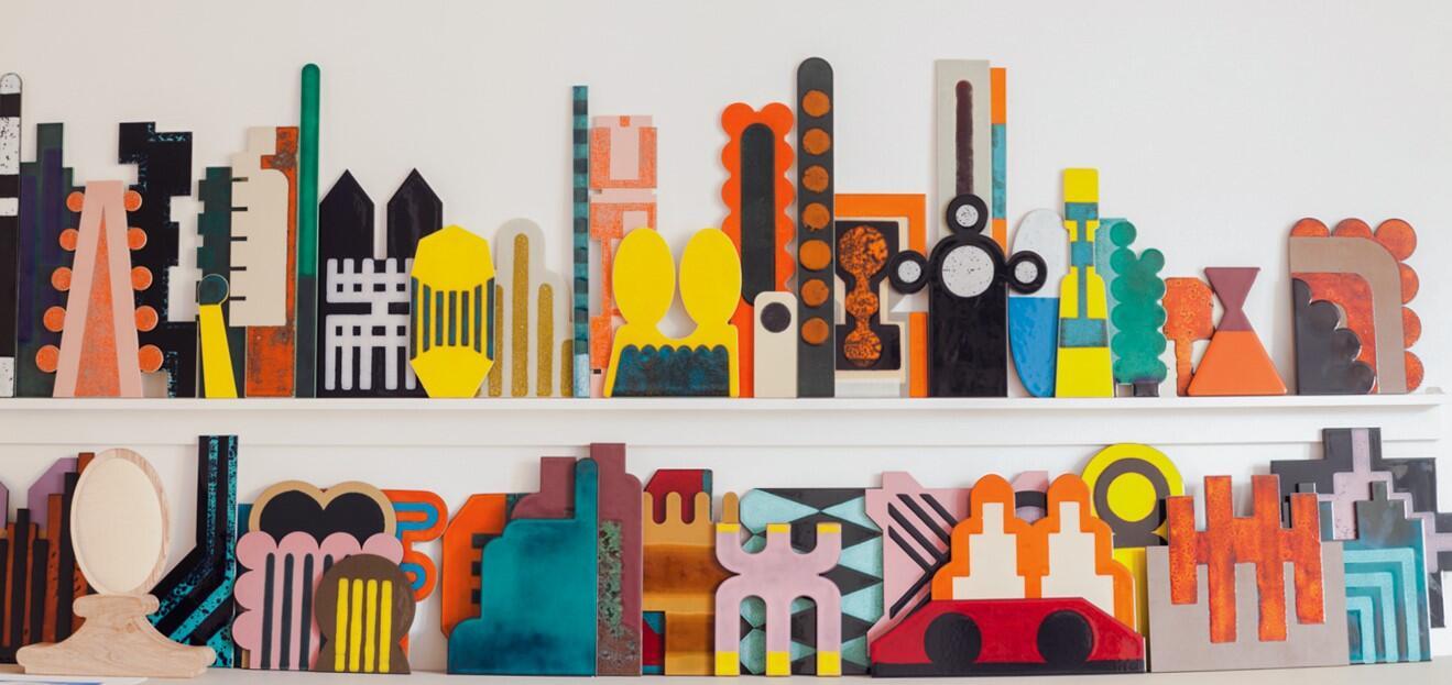 multicoloured ceramics and artworks in studio