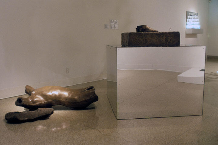 The Great Black Airmen (Tuskegee) 1996 wood, resin, plexiglass, tar, feathers, paper, bonded bronze Base: 45 x 41 x 45 inches, Torso: 12 x 40 x 56 inches Installation image Courtesy of the Michael Richards Estate