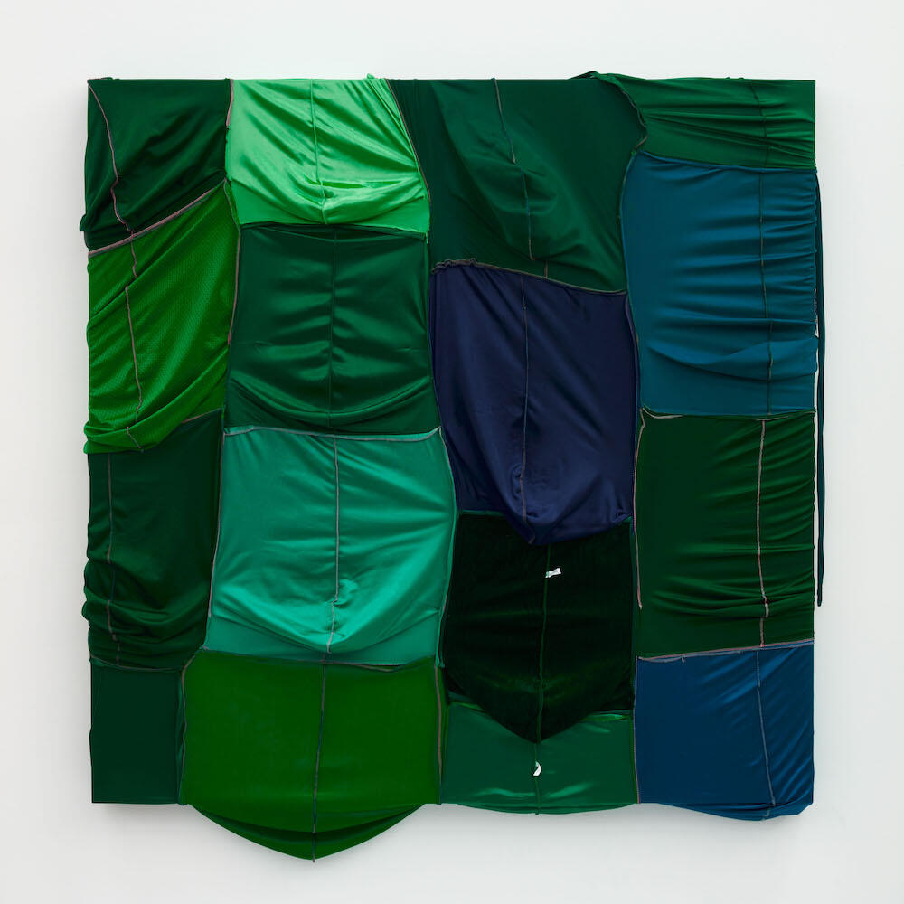 Anthony Olubunmi Akinbola   CAMOUFLAGE #073 (John Deere), 2021   durags and acrylic on wood panel   Image Courtesy of the artist and Night Gallery