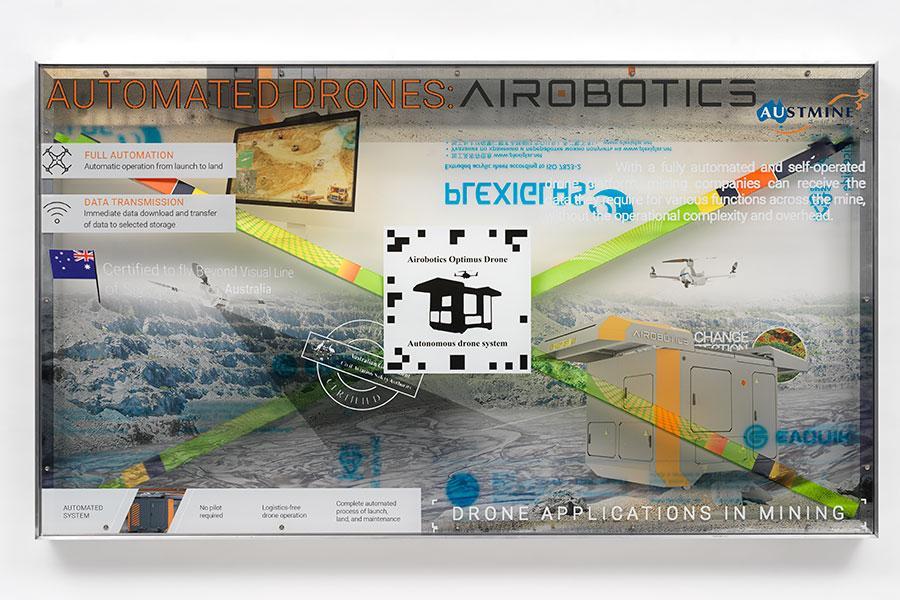 Airobotics Optimus Autonomous drone and docking station promotion screen video token 2019 Aluminum, UV print on plexiglas, fluorescent light tubes in original cardboard packaging 26.77 x 47.24 x 3.94 inches 68 x 120 x 10 cm