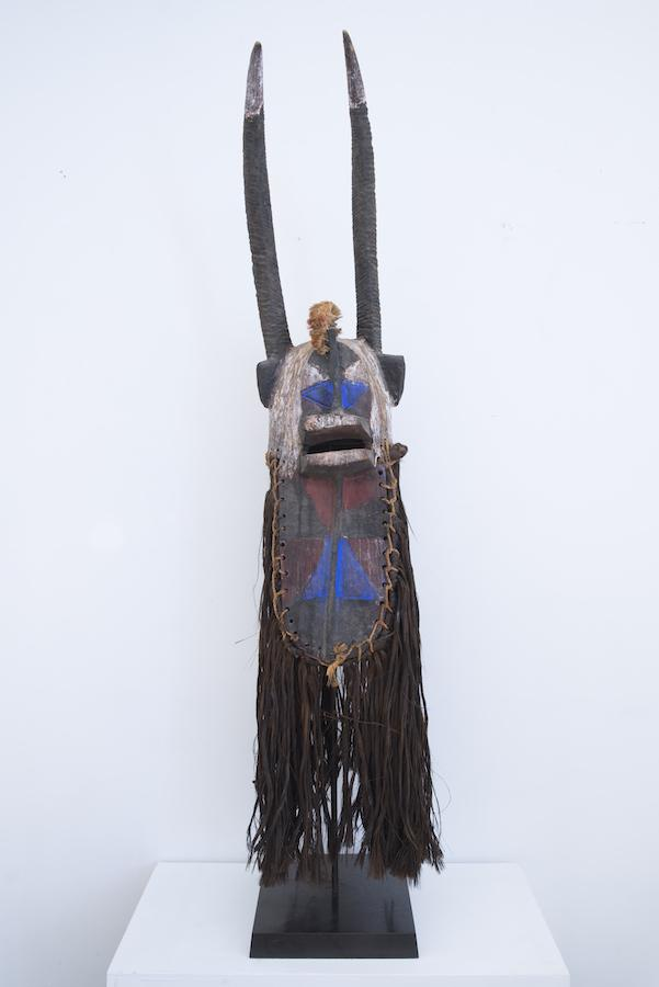 Unknown, Tall, horned Bobo funerary mask, Burkina Faso, c. 1930  Carved wood with earth pigments and commercial bluing, indigenous fiber  65 x 13 x 12 in.