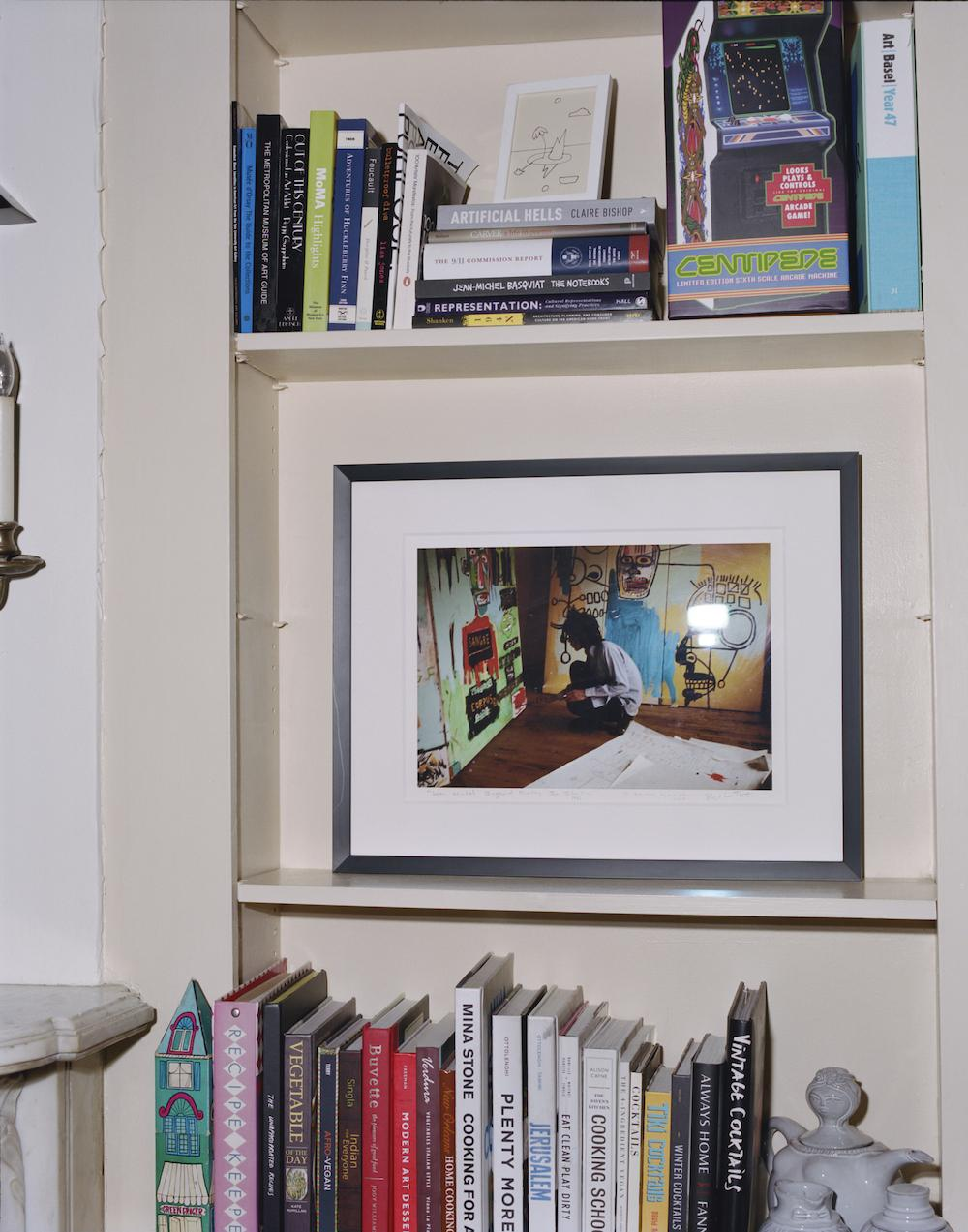 A detail of Victoria Rogers' library inside her home with a framed photograph of Jean-Michel Basquiat in his studio. Photo:DaveyAdesida