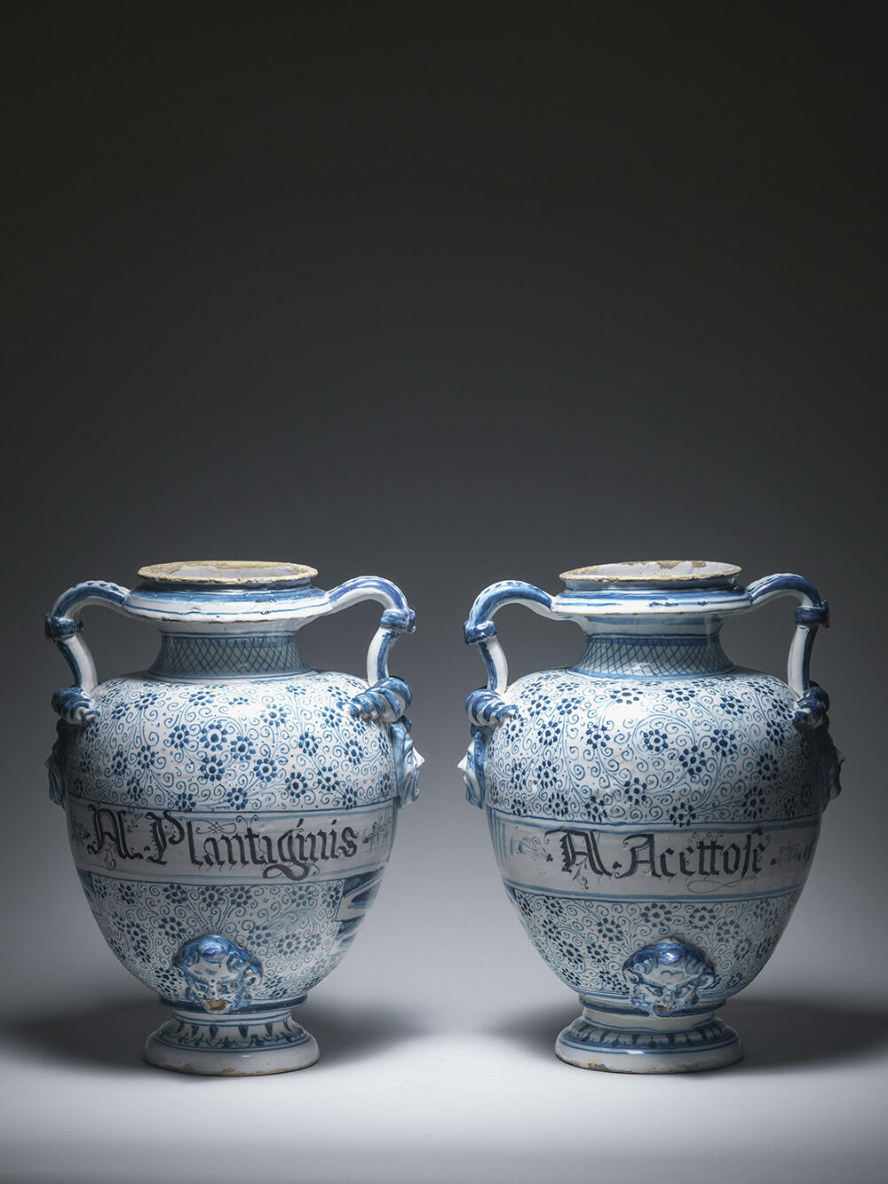 Two large pharmacy jars, stagnone, with spiral decoration inspired by 'Golden Horn' ware from Iznik, inscribed for Acqua Plantaginis and Acqua Acettose, Savona or Albissola, first half 17th century. 40 cm.