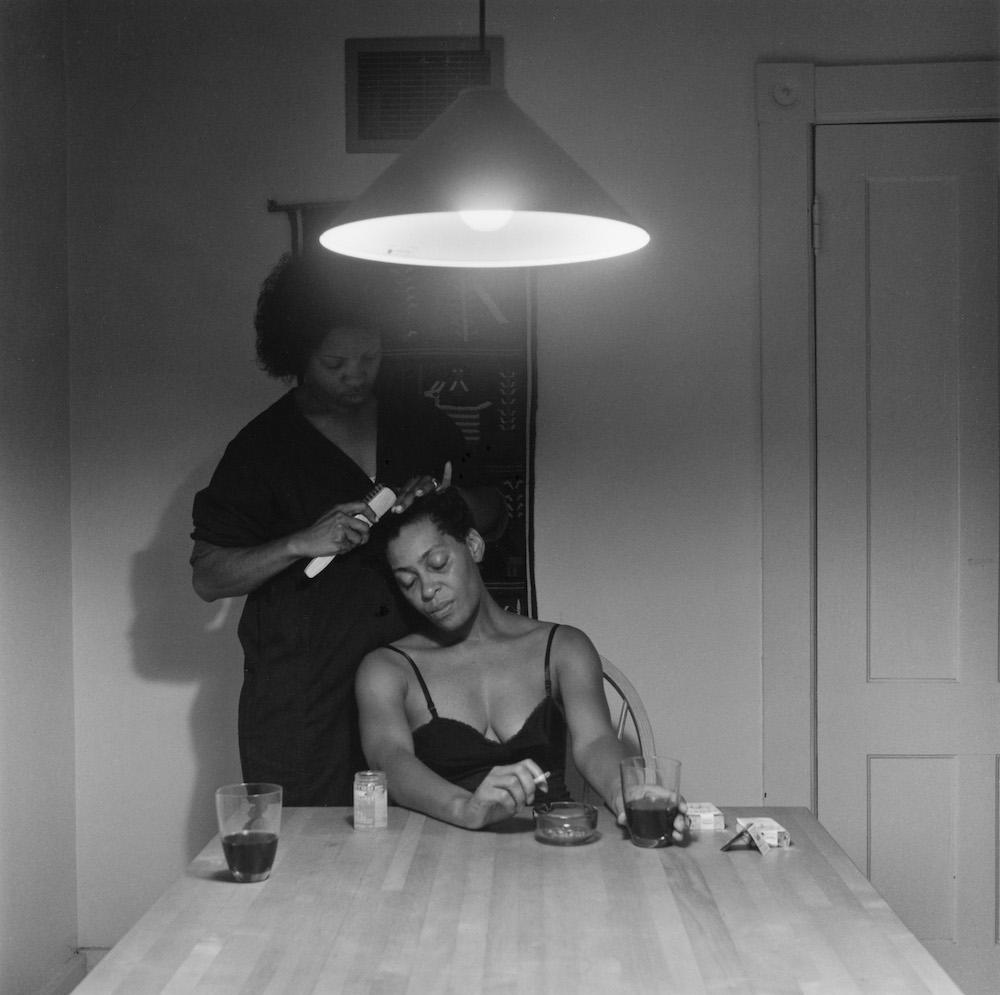 Carrie Mae Weems, Untitled (Woman brushing hair), 1990, silver print, 72 × 72 cm. Courtesy: © Carrie Mae Weems and Jack Shainman Gallery, New York