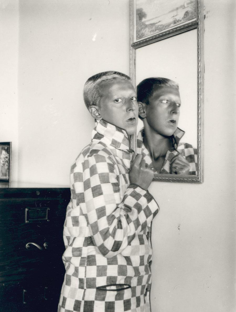 Claude Cahun, Self-Portrait (Reflected in Mirror, Chequered Jacket), 1928, gelatin-silver print. Courtesy: © Estate of Claude Cahun  and Jersey Heritage Collection