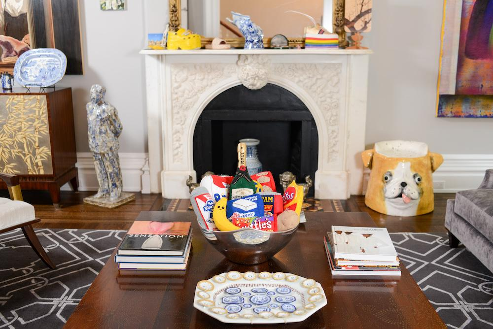 on the coffee table: felt pieces by Lucy Sparrow, ceramic piece by Mara Superior; sculptures in the background from left to right: Alben, Andy Edelstein, Didi Rojas, Curtis Santiago, Alison Elizabeth Taylor; dog stool by Katie Kimmel