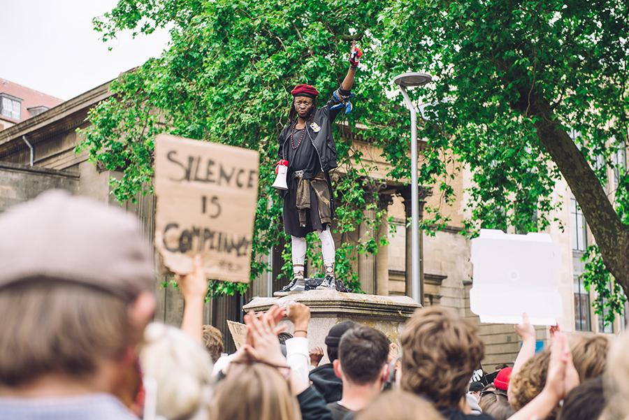 Solomon O.B speaking to a crowd from the pedestal that once hosted the statue of Edward Colston, Bristol, 2020. Courtesy: Getty Images; photograph: Giulia Spadafora/NurPhoto