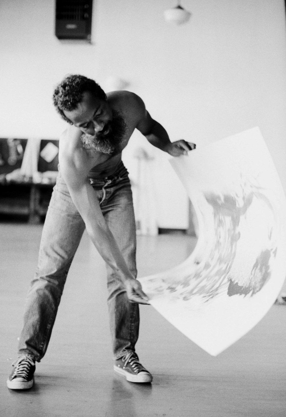 David Hammons making a body print, Slauson Avenue studio, Los Angeles, 1974, digital silver gelatin print, 41 × 51 cm. Courtesy: the artist and The Drawing Centre, New York