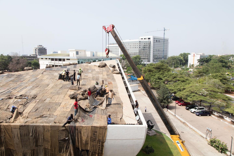 Collaborators install jute sacks to Ghana's national theatre