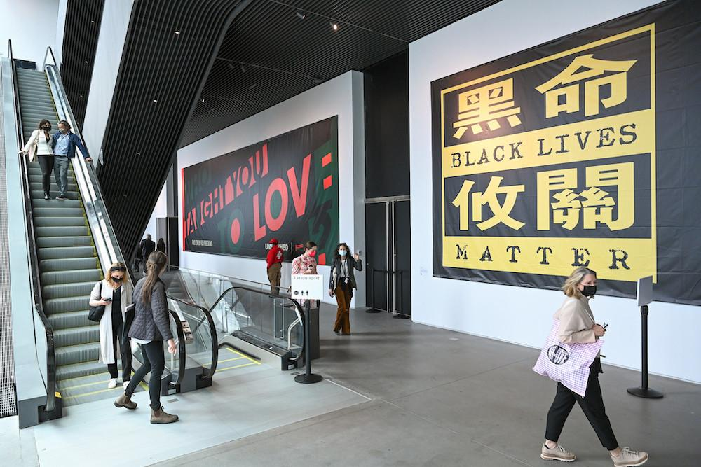 Billboards by Hank Willis Thomas (left) and Mel Chin (right) at Frieze New York at The Shed, 2021. Realized in collaboration with For Freedoms